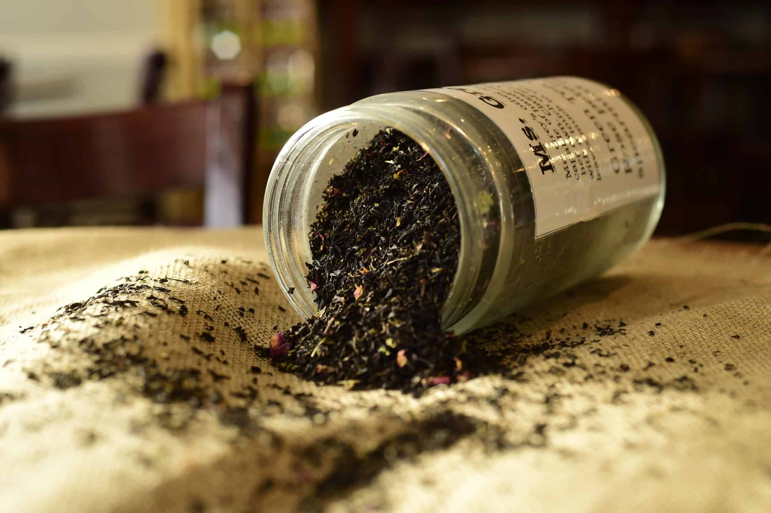 Loose leaf tea spilling out onto a table