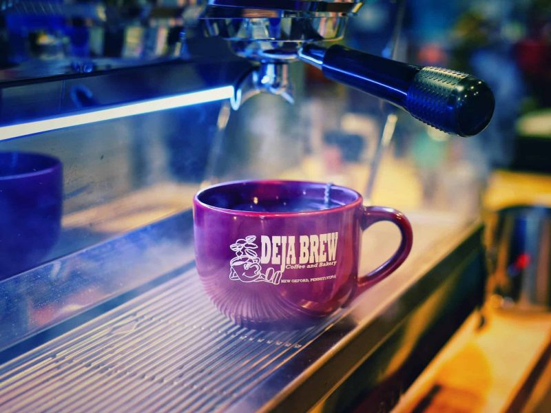 deja brew mug with espresso being made